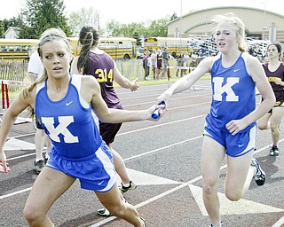 JFK's Kelli Gaurneni, left, takes hand off from Meghanne Perisa during final leg of 4X800 at Chaney Thursday. In background Mooney's Dina Daltorio hands off to Alex Sierra. JFK won, Mooney came in 2nd.