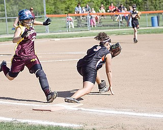 South Range Emily Seman (32) gets out by Springfield Rebecca Evan (3) at first base during the first inning Friday.