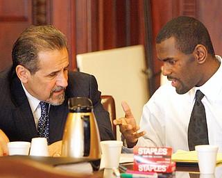 Antwon Lanier talks to his attorney, James Gentile, in the murder case in Judge John Durkins courtroom.