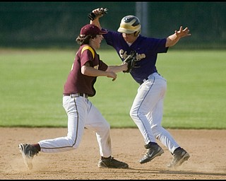 5.19.2009 South Range's Vince Miller tags Champion's Rick Yauger on his way to third base during the bottom of the fourth inning at Cene Park on Tuesday evening. Geoffrey Hauschild