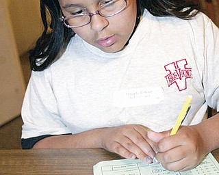 Mikayla Roberts, LaBrae Middle School 5th grader, competes in Equation event Tuesday.