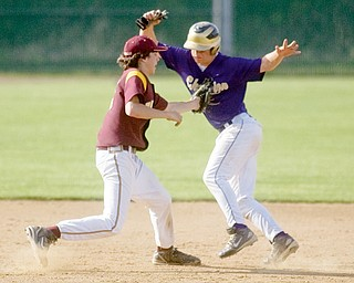 South Range's Vince Miller tags Champion's Rick Yauger on his way to third base during the bottom of the fourth inning at Cene Park on Tuesday evening.