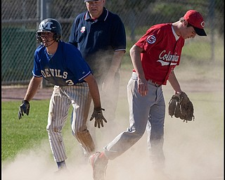 5.20.2009 McDonald's Mike Thomas (3) slides safe into third base as Columbiana's Tyler Denmeade (12) lands after making the catch during the bottom of the fourth inning at Cene Field on Wednesday afternoon.