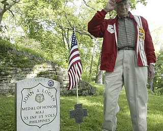 Raymond Braidich a WWII Marine veteran from Poland salutes a flag on the grave of Maj. John A. Logan. A group of veterans and volunteers decorated graves there.  Maj. Logan is son of General John A. Logan who issued General Order11 at the end of the Civil War resulting in Decoration Day and then Memorial Day.