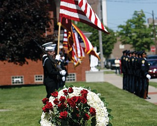 Officers of the YPD honor guard under the direction of Robin Lees fire a 21 gun salute to fallen officers.