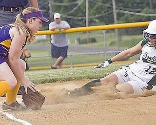 Ursuline Kasey Foley (18) slides into 3rd base to be safe when Champion Megan Frantz (30) can't get her out in the 2nd inning at Friday's game in Lisbon, May 22, 2009.