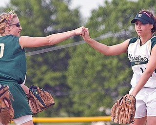 Ursuline's Anna Donko (20) and Miranda Carkido (15) at the Friday game in Lisbon against Champion, May 22, 2009.