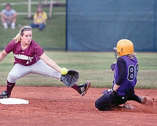 Boardman's Jamie Massaro (27) reaches at to make the catch as Jackson High School's Maddy Richards (88) at second base during the top of the fourth inning at The University of Akron's Lee Jackson Softball Field on Wednesday afternoon.