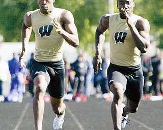 Harding's DeAver Williamson, left, edges out Harding's Joseph Threats to win boys 100-meter dash Friday, May 29, at Austintown Fitch.