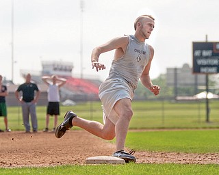 Pitcher, Todd Kibby, runs the bases during practice at Springfield High School on Tuesday evening.