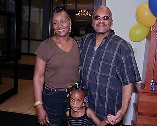 This is a photo of DWAYNE AND MARY WILLIAMSON of Warren with their granddaughter.