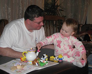 ROB WARDLE of Youngstown with daughter MAGGIE ROSE in their Saturday suits — Guiness T-shirt for dad and piggie sleeper for daughter. (Submitted by mom/grandma Marg Yannucci of Youngstown.)