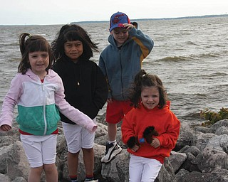 """""""Not So Red, White and Blue"""" was the Memorial Day attire at Lake Erie for the VARI-COPPOLA family siblings — Carli, 4; Kate, 6; Patrick, 4; and Lily, 4; all of Lowellville.The kids were bundled up because the wind was kicking up and there was a chill in the air, according to Mom, Jodi."""