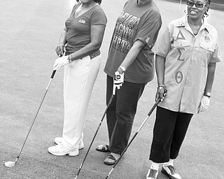 <p>The Vindicator/Lisa-Ann Ishihara</p> <p>Decisions, decisions: The problem of deciding which club they will rely on when competing in the Red and White Scholarship Scramble on June 20 is solved by, from left, Agnes Kimbrough, Camille Pinkard and Octavia Payne, Delta Sigma Theta committee members, who display their favorite clubs as they prepare for a practice round.</p>