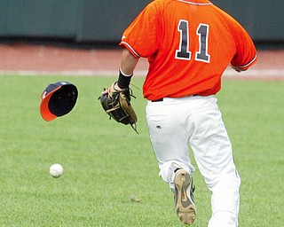 Springfield's Ronnie Bovo loseshis hat while trying to run down a hit off the bat of Patrick Henry's Austinton Bower.