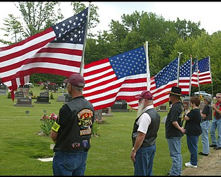 Members of the Patriot Guard Riders  honor guard hold flags for the funeral of Army Chief Warrant Officer S. Blane Hepfner at Hubbard Union Cemetery.