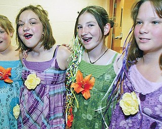 """Canfield Middle School students, from left to right, Angela Paterchak, Alania Fuller, Bridget Griffin and Jess Paterchak sing """"Love Story"""" during Tuesday talent show at the school."""