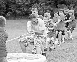 TUG OF WAR: Mike Zembower, a parent volunteer at the PTO of North Elementary, pitches in to help the Red Team. The PTO at Poland North Elementary put on a carnival on the last day of class for the students.