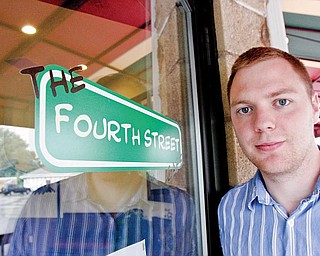 Fourth Street Cafe owner Evan Egli outside his business.