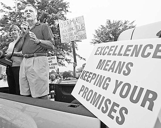 Chuck Cunningham, former senior executive at Delphi Packard Electric, who with his wife, Mary Ann, also a retired Delphi executive, at the Delphi Salaried retirees rally at the Larchmont Plant in Warren.