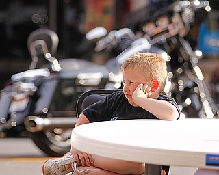 "Zayne Gause (5) of Youngstown listens to Tie 1 On at West Federal Plaza for ""Rally in the Valley""  Sunday June 14, 2009