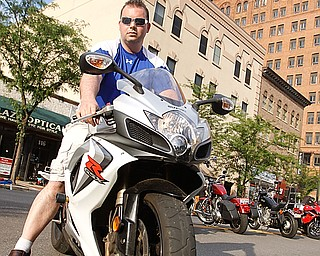 "Rosetta Stone owner Greg Sop on his Suzuki GSXR down West Federal Plaza for ""Rally in the Valley""  Sunday June 14, 2009