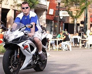 "Rosetta Stone owner Greg Sop rides his Suzuki GSXR down West Federal Plaza for ""Rally in the Valley""  Sunday June 14, 2009
