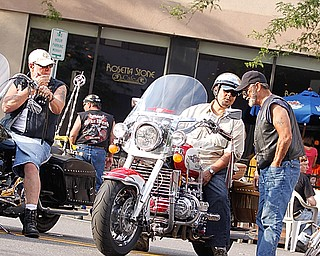 "Seanus McClung of Canfield, Frank Guzman of Poland and John Pero of Hubbard talk shop during the bike gathering ""Rally in the Valley""  Sunday June 14, 2009
