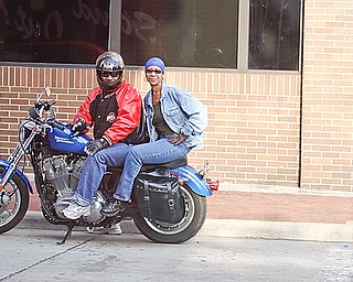 "James and Kim Mitchell of Youngstown sit on their Harley Davidson 883 sportsters and listen to Tie 1 On at ""Rally in the Valley""  Sunday June 14, 2009