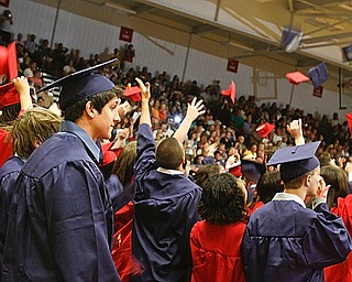 Far right, David Yohman keeps his cap as his fellow classmates throw them into the air at Austintown Fitch High School's Class of 2009 commencement Sunday June 14, 2009