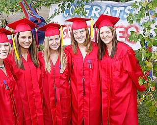 Sam Shiley, BreAnna Remias, Miranda Weaver, Rory Sachire and Samatha Custer pose for photos at Austintown Fitch High School after their Class of 2009 commencement Sunday June 14, 2009