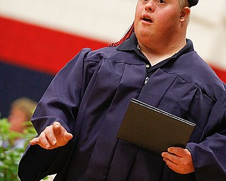 Kenneth Wilcox walks away from the stage with his diploma at Austintown Fitch High School's Class of 2009 commencement Sunday June 14, 2009