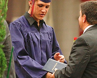Mohamed Ramahi receives his diploma at Austintown Fitch High School's Class of 2009 commencement Sunday June 14, 2009