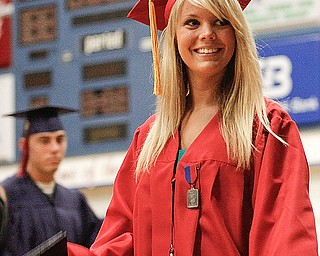 Kylie Arnett smiles at her family after crossing the stage to receive her diploma at Austintown Fitch High School's Class of 2009 commencement Sunday June 14, 2009