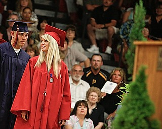 Kylie Arnett says a couple quick words to Jason Bagoly before she crosses the stage to receive her diploma at Austintown Fitch High School's Class of 2009 commencement Sunday June 14, 2009