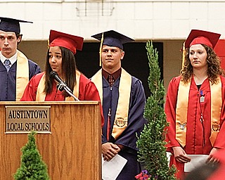 Jena Baun at podium with her fellow Valedictorians of Austintown Fitch High School's Class of 2009, L-R in back, Kayla Schindler, Mark Radetic, Nicholas Mancuso, Theresa Izzo and Ashley Guittar, Sunday June 14, 2009