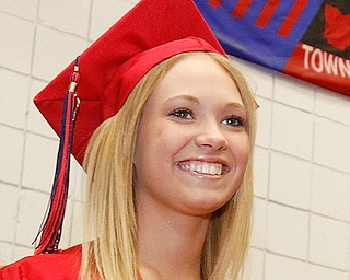 Chelsea Reed is all smiles walking into Austintown Fitch's gymnasium with her fellow graduates for the Class of 2009 commencement, Sunday June 14, 2009