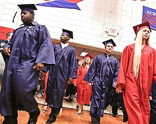 Class of 2009 enters their gymnasium at Austintown Fitch High School to receive their diplomas Sunday June 14, 2009
