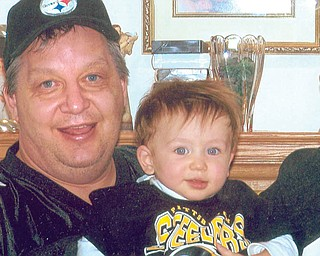 John Puhalla, 46, and Andrew, 1 1/2, of Boardman.