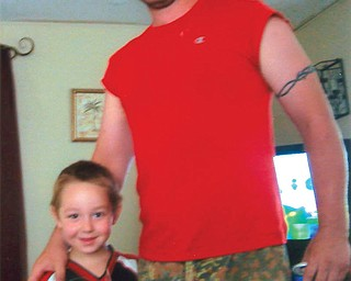 Dan Kurpely, 25, and Kane, 5, of East Liverpool.