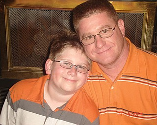 Bill Tomory, 39, and Jake, 12, of Canfield.