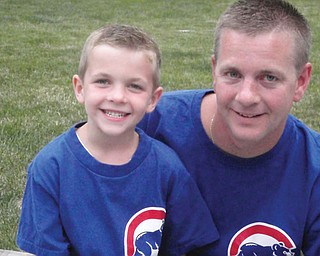 Tim Hughes, 35, and Jake, 6, of Boardman.