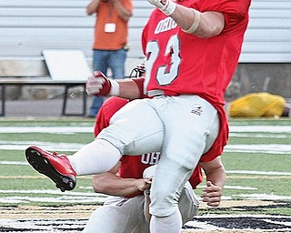 ALL STAR - Josh Harold of Columbiana watches his 54 yard field goal sail through the up rights Friday night. - Special to The Vindicator/Nick Mays