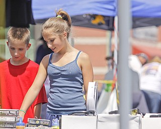 11 year old twins Ryan and Veronica Kost of Columbiana check out what the vendors had to offer at the Mahoning Valley Rib Burnoff Saturday June 27, 2009