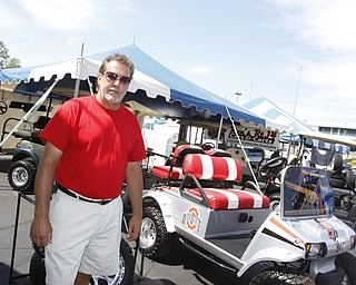 Ron Kost of Columbiana at his tent for the Mahoning Valley Rib Burnoff Saturday June 27, 2009