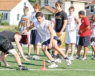 Tyler McNally (14) of Struthers races against Dean Steliotes (14) of Pittsburgh, PA during Cardinal Mooney Camp of Champions at the football field, Monday June 29, 2009Lisa-Ann Ishihara