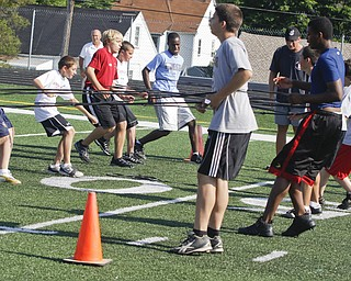 Kids test their agility during Cardinal Mooney Camp of Champions at the football field, Monday June 29, 2009Lisa-Ann Ishihara