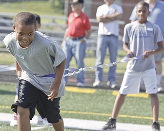 Jared Perdue (9) of Youngstown and Aaron Woodberry (11) of Youngstown participate in an exercise to test their agility during Cardinal Mooney Camp of Champions at the football field, Monday June 29, 2009Lisa-Ann Ishihara