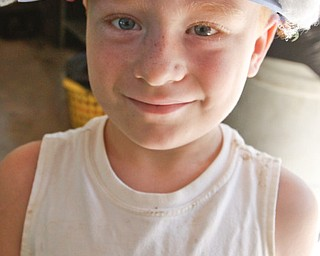 Michael Byers (7) of Girard shows off his newly decorated visor at summer day camp in Churchill Park in Liberty run by Rose Buhley, Monday June 29, 2009Lisa-Ann Ishihara