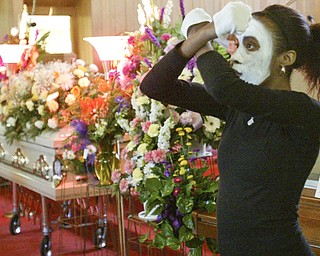 Ayana Durden, a member of I Mime, a mime ministry at Third Baptist Church in Youngstown, performs during the Wednesday funeral of Edna Pincham.